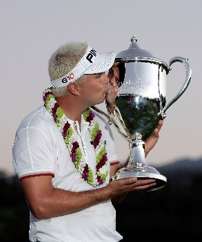 KAPALUA, HI - JANUARY 06:  Daniel Chopra of Sweden kisses the trophy after winning the Mercedes- Benz Championship on at the Plantation Course January 6, 2008 in Kapalua, Maui, Hawaii.  (Photo by Jeff Gross/Getty Images)