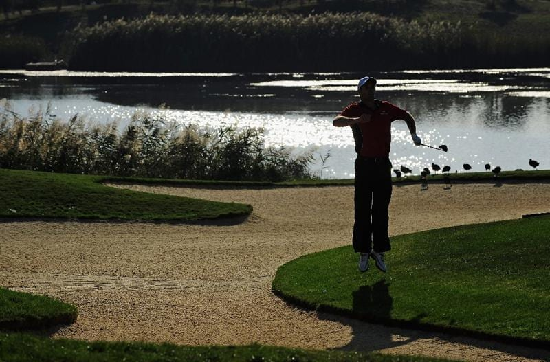 VILAMOURA, PORTUGAL - OCTOBER 17:  Padraig Harrington of Ireland jumps on the 14th hole during the third round of the Portugal Masters at the Oceanico Victoria Golf Course on October 17, 2009 in Vilamoura, Portugal.  (Photo by Stuart Franklin/Getty Images)