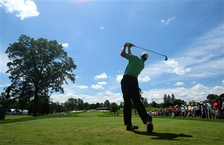 BLOOMFIELD HILLS, MI - AUGUST 06:  Retief Goosen of South Africa plays a shot in front of a gallery during a practice round prior to the 90th PGA Championship at Oakland Hills Country Club on August 6, 2008 in Bloomfield Township, Michigan.  (Photo by Stuart Franklin/Getty Images)