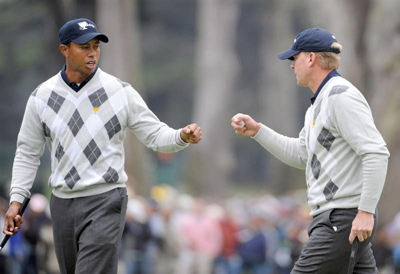 SAN FRANCISCO - OCTOBER 10:  Tiger Woods and Steve Stricker of the USA Team celebrates a half point on the 14th hole during the Day Three Morning Foursome Matches of The Presidents Cup at Harding Park Golf Course on October 10, 2009 in San Francisco, California.  (Photo by Harry How/Getty Images)