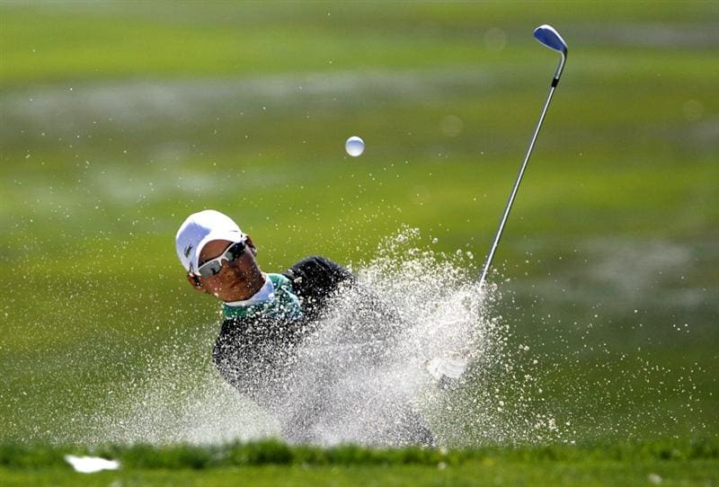 DANVILLE, CA - OCTOBER 12: Yani Tseng of Taiwan chips out of a bunker on the 8th hole during the final round of the LPGA Longs Drugs Challenge at the Blackhawk Country Club October 12, 2008 in Danville, California. (Photo by Max Morse/Getty Images)