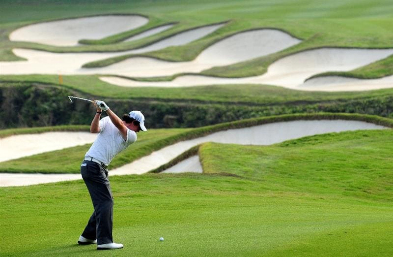 SHENZHEN, GUANGDONG - NOVEMBER 26:  Rory McIlroy of Ireland plays his approach shot on the 15th hole during Fourball on the first day of the Omega Mission Hills World Cup on the Olazabal course on November 26, 2009 in Shenzhen, China.  (Photo by Stuart Franklin/Getty Images)