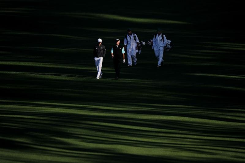 AUGUSTA, GA - APRIL 07:  Camilo Villegas of Colombia and Jerry Kelly walk up the second fairway with caddies Mick Doran and Eric Meller during the first round of the 2011 Masters Tournament at Augusta National Golf Club on April 7, 2011 in Augusta, Georgia.  (Photo by Harry How/Getty Images)