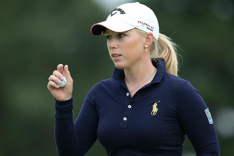 SHIMA, JAPAN - NOVEMBER 07:  Morgan Pressel of the United States acknowledges the crowd after sinking a putt on the green of the 18th hole during the final round of the Mizuno Classic at Kintetsu Kashikojima Country Club on November 7, 2010 in Shima, Mie, Japan.  (Photo by Kiyoshi Ota/Getty Images)