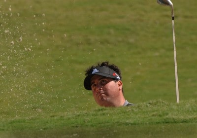 Pat Perez blasts from a deep bunker at the 18th green during  a practice round  at the 2006 Honda Classic March 7 at the Country Club at Mirasol in Palm Beach Gardens, Florida.Photo by Al Messerschmidt/WireImage.com