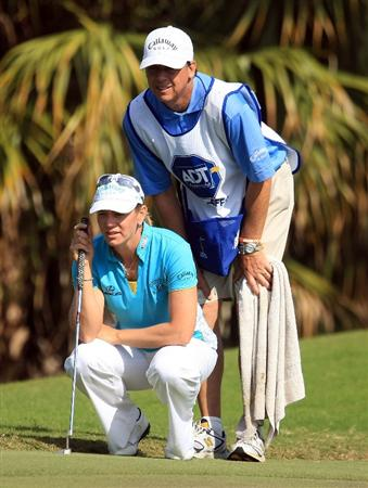 WEST PALM BEACH, FL - NOVEMBER 21:  Annika Sorenstam of Sweden lines up a putt with her caddie Terry MacNamara on the eighth green during the second round of the ADT Championship at the Trump International Golf Club on November 21, 2008 in West Palm Beach, Florida.  (Photo by Scott Halleran/Getty Images)
