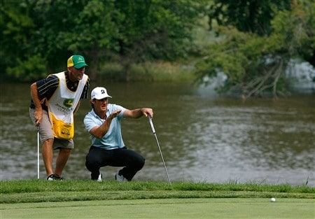 SILVIS, IL - JULY 12:  Will MacKenzie discusses his birdie putt with his caddie on the 16th green during the third round of the 2008 John Deere Classic at TPC at Deere Run on Saturday, July 12, 2008 in Silvis, Illinois.  (Photo by Kevin C. Cox/Getty Images)