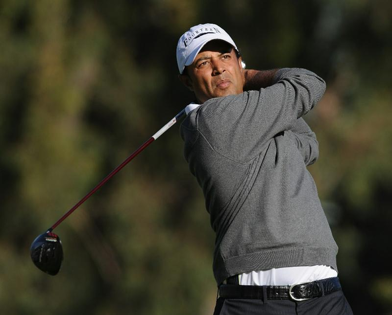 PACIFIC PALISADES, CA - FEBRUARY 17: Arjun Atwal of India plays his tee shot on the second hole during the first round of the Northern Trust Open at Riviera Country Club on February 17, 2011 in Pacific Palisades, California.  (Photo by Stuart Franklin/Getty Images)