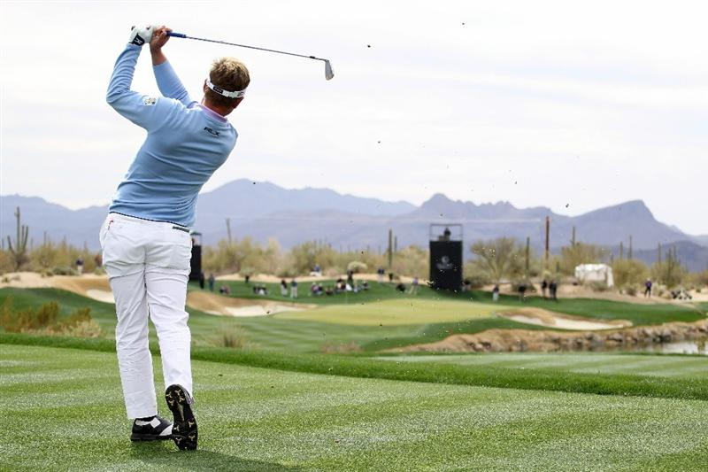 MARANA, AZ - FEBRUARY 26:  Luke Donald of England hits his tee shot on the third hole during the semifinal round of the Accenture Match Play Championship at the Ritz-Carlton Golf Club on February 26, 2011 in Marana, Arizona.  (Photo by Andy Lyons/Getty Images)