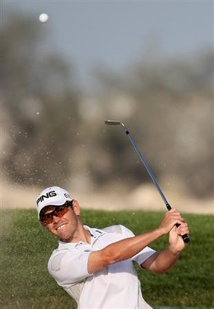 DOHA, QATAR - JANUARY 25:  Louis Oosthuizen of South Africa plays his second shot on the par three 13th hole during the final round of the Commercialbank Qatar Masters at the Doha Golf Club on January 25, 2009 in Doha, Qatar.  (Photo by Ross Kinnaird/Getty Images)