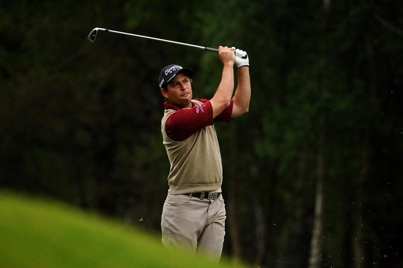 VIRGINIA WATER, ENGLAND - MAY 20:  David Howell of England hits his second shot on the 9th hole during the first round of the BMW PGA Championship on the West Course at Wentworth on May 20, 2010 in Virginia Water, England.  (Photo by Richard Heathcote/Getty Images)