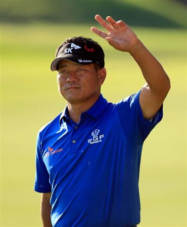 PONTE VEDRA BEACH, FL - MAY 15:  K.J. Choi of South Korea waves to fans during the final round of THE PLAYERS Championship held at THE PLAYERS Stadium course at TPC Sawgrass on May 15, 2011 in Ponte Vedra Beach, Florida.  (Photo by Sam Greenwood/Getty Images)