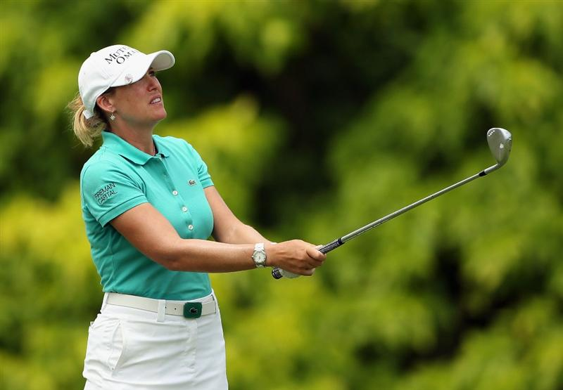 SINGAPORE - FEBRUARY 25:  Cristie Kerr of the USA plays her third shot on the fifth hole during the second round of the HSBC Women's Champions at the Tanah Merah Country Club on February 25, 2011 in Singapore.  (Photo by Andrew Redington/Getty Images)