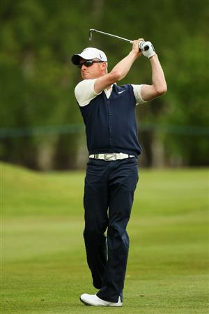 VIRGINIA WATER, ENGLAND - MAY 20:  Simon Dyson of England plays an iron shot during the first round of the BMW PGA Championship on the West Course at Wentworth on May 20, 2010 in Virginia Water, England.  (Photo by Ian Walton/Getty Images)