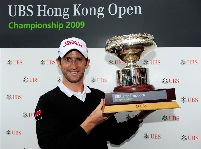 HONG KONG - NOVEMBER 15:  Gregory Bourdy of France holds the winners trophy after winning the UBS Hong Kong Open at the Hong Kong Golf Club on November 15, 2009 in Fanling, Hong Kong.  (Photo by Stuart Franklin/Getty Images)