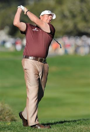 PEBBLE BEACH, CA - FEBRUARY 13:  Phil Mickelson plays his approach shot on the second hole during the final round of the AT&T Pebble Beach National Pro-Am at Pebble Beach Golf Links on February 13, 2011  in Pebble Beach, California.  (Photo by Stuart Franklin/Getty Images)