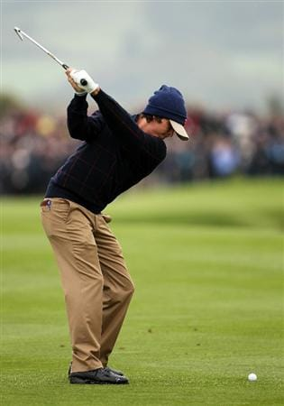 NEWPORT, WALES - SEPTEMBER 30:  Rickie Fowler of the USA hits an iron shot during a practice round prior to the 2010 Ryder Cup at the Celtic Manor Resort on September 30, 2010 in Newport, Wales.  (Photo by Jamie Squire/Getty Images)