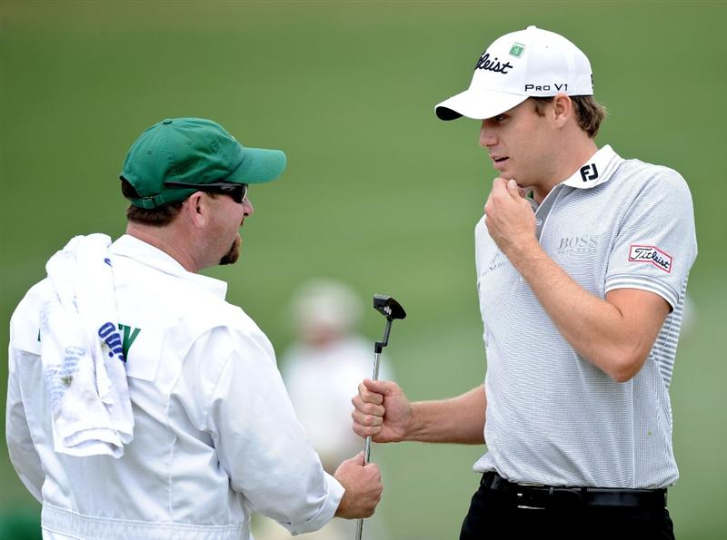 AUGUSTA, GA - APRIL 08:  Nick Watney hands his putter to his caddie Tim Goodell on the second green during the first round of the 2010 Masters Tournament at Augusta National Golf Club on April 8, 2010 in Augusta, Georgia.  (Photo by Harry How/Getty Images)