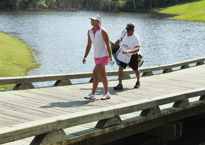 MOBILE, AL - APRIL 30:  Alexis Thompson crosses a bridge on the 18th hole alongside her father/caddie Scott during the third round of the Avnet LPGA Classic at the Crossings Course at the Robert Trent Jones Trail at Magnolia Grove on April 30, 2011 in Mobile, Alabama.  (Photo by Scott Halleran/Getty Images)