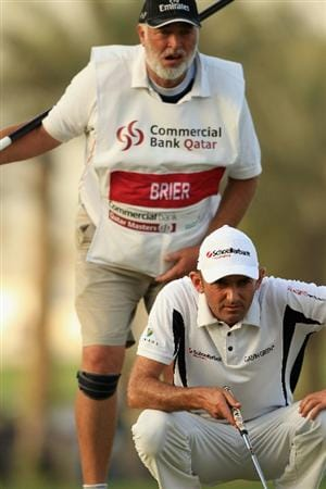 DOHA, QATAR - FEBRUARY 05:  Markus Brier of Austria and his caddie line up a putt on the 18th hole during the third round of the Commercialbank Qatar Masters held at Doha Golf Club on February 5, 2011 in Doha, Qatar.  (Photo by Andrew Redington/Getty Images)