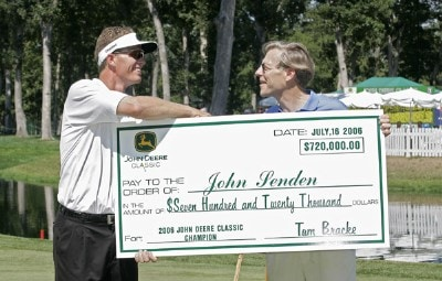John Senden accepts the winner's check after the final round of the John Deere Classic at TPC Deere Run in Silvis, Illinois on July 16, 2006.Photo by Michael Cohen/WireImage.com