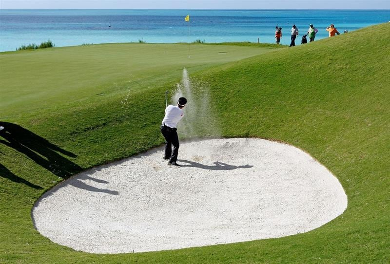 SOUTHAMPTON, BERMUDA - OCTOBER 20:  Y.E. Yang of South Korea, the 2009 PGA Championship winner, hits his second shot on the 16th hole during the first round of the PGA Grand Slam of Golf on October 20, 2009 Port Royal Golf Course in Southampton, Bermuda.  (Photo by Andy Lyons/Getty Images)