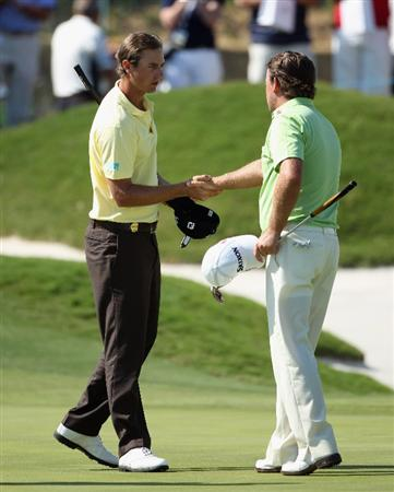 CASARES, SPAIN - MAY 21:  Nicolas Colsaerts of Belgium (left) shakes hands with Graeme McDowell of Northern Ireland after winning their quarter final match of the Volvo World Match Play Championship at Finca Cortesin on May 21, 2011 in Casares, Spain.  (Photo by Andrew Redington/Getty Images)