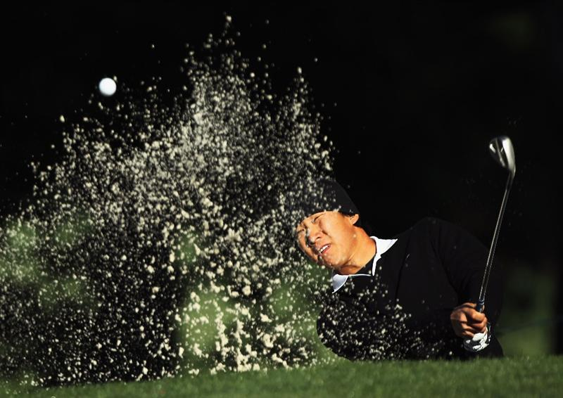 CHARLOTTE, NC - MAY 05:  Anthony Kim plays a bunker shot on the 12th hole during the first round of the Wells Fargo Championship at the Quail Hollow Club on May 5, 2011 in Charlotte, North Carolina.  (Photo by Scott Halleran/Getty Images)