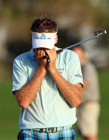 ABU DHABI, UNITED ARAB EMIRATES - JANUARY 21:  Ian Poulter of England cannot believe he has holed a huge birdie putt at the par 5, 18th hole during the first round of The Abu Dhabi Golf Championship at Abu Dhabi Golf Club on January 21, 2010 in Abu Dhabi, United Arab Emirates.  (Photo by David Cannon/Getty Images)