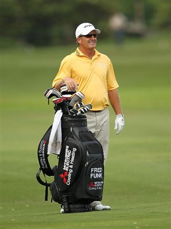 LUTZ, FL - APRIL 16:  Fred Funk waits to play his approach on the  14th hole during the second round of the Outback Steakhouse Pro-Am at the TPC of Tampa on April 16, 2011 in Lutz, Florida.  (Photo by Mike Ehrmann/Getty Images)
