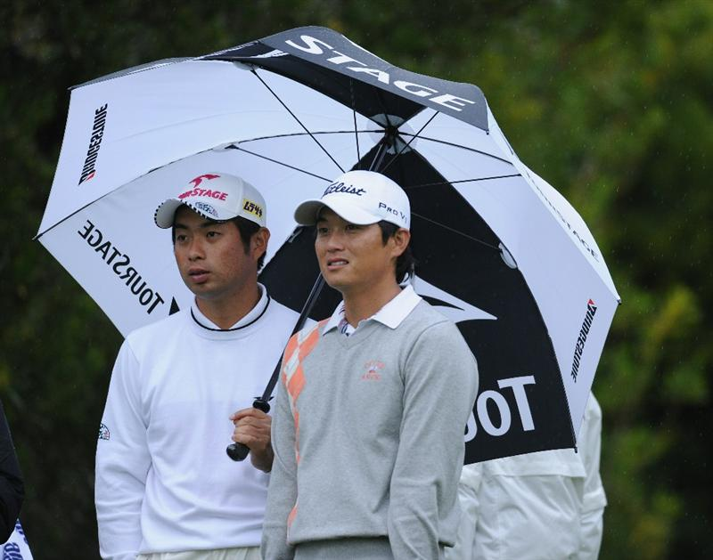 PACIFIC PALISADES, CA - FEBRUARY 18:  Yuta Ikeda and Ryuji Imada of Japan ponder during the second round of the Northern Trust Open at Riviera Country Club on February 18, 2011 in Pacific Palisades, California.  (Photo by Stuart Franklin/Getty Images)