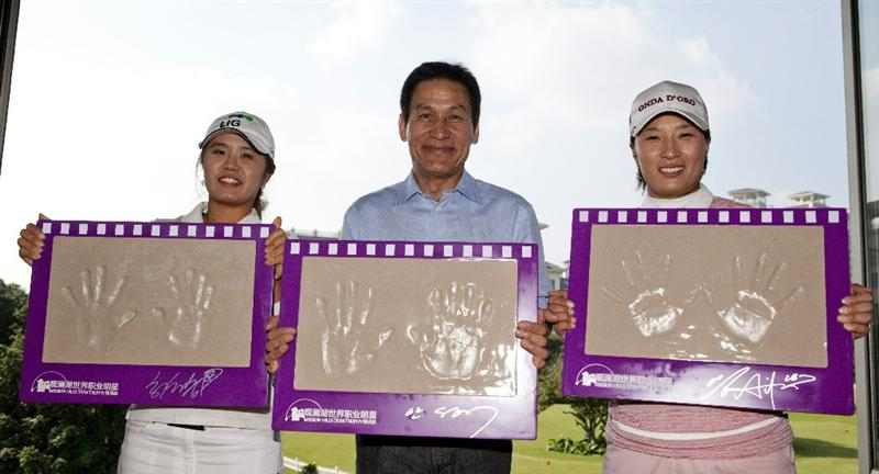 HAIKOU, CHINA - OCTOBER 29: (L-R) Golfer He Yong Choi Of Korea, actor  Ahn Sung-Ki of Korea and golfer Se Ri Park of Korea pose with their handprints during a press conference as part of the Mission Hills Star Trophy tournament at Mission Hills Resort on October 29, 2010 in Haikou, China. The Mission Hills Star Trophy is Asia's leading leisure liflestyle event and features Hollywood celebrities and international golf stars.  (Photo by Athit Perawongmetha/Getty Images for Mission Hills)