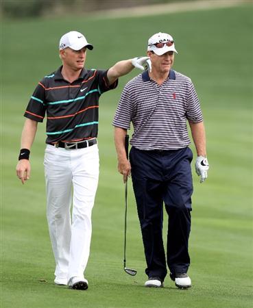 DUBAI, UNITED ARAB EMIRATES - FEBRUARY 05:  Simon Dyson of England and Tom Watson of the USA during the second round the Omega Dubai Desert Classic on the Majlis Course at the Emirates Golf Club on February 5, 2010 in Dubai, United Arab Emirates.  (Photo by Ross Kinnaird/Getty Images)