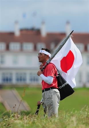 TURNBERRY, SCOTLAND - JULY 17:  A Japanese fan enjoys the action during round two of the 138th Open Championship on the Ailsa Course, Turnberry Golf Club on July 17, 2009 in Turnberry, Scotland.  (Photo by Stuart Franklin/Getty Images)