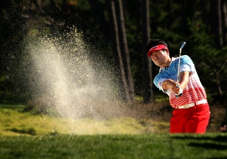 PEBBLE BEACH, CA - FEBRUARY 10:  Y.E. Yang of Korea hits out of a fairway bunker on the 13th hole during the final round of the AT&T Pebble Beach National Pro-Am on Pebble Beach Golf Links on February 10, 2008 in Pebble Beach. California.  (Photo by Stephen Dunn/Getty Images)