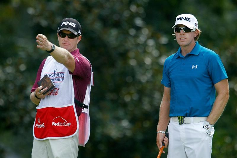 ATLANTA - SEPTEMBER 23:  Hunter Mahan (R) talks with his caddie John Wood (L) on the eighth hole during the first round of THE TOUR Championship presented by Coca-Cola at East Lake Golf Club on September 23, 2010 in Atlanta, Georgia.  (Photo by Scott Halleran/Getty Images)
