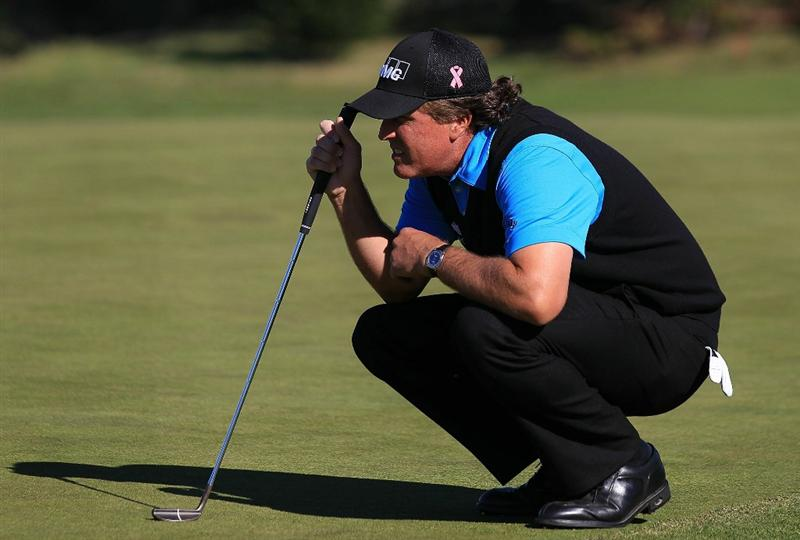PEBBLE BEACH, CA - FEBRUARY 11:  Phil Mickelson lines up a putt on the second hole at the AT&T Pebble Beach National Pro-Am- Round Two at the Spyglass golf club on February 11, 2011 in Pebble Beach, California.  (Photo by Jed Jacobsohn/Getty Images)