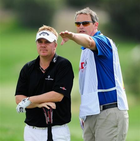 MADRID, SPAIN - MAY 27:  Ross McGowan of England and caddie Matt Harbour discuss his approach shot on the 16th hole during the first round of the Madrid Masters at Real Sociedad Hipica Espanola Club De Campo on May 27, 2010 in Madrid, Spain.  (Photo by Stuart Franklin/Getty Images)