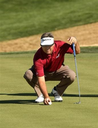 SCOTTSDALE, AZ - FEBRUARY 01:  Kenny Perry places his ball on the 12th green during the final round of the FBR Open on February 1, 2009 at TPC Scottsdale in Scottsdale, Arizona.  Perry went on to win on the third playoff hole.  (Photo by Stephen Dunn/Getty Images)