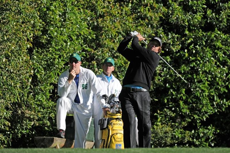 AUGUSTA, GA - APRIL 06:  Phil Mickelson watches a shot as caddies Joe Lacava and Michael Christensen look on during a practice round prior to the 2011 Masters Tournament at Augusta National Golf Club on April 6, 2011 in Augusta, Georgia.  (Photo by Harry How/Getty Images)