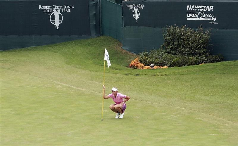 PRATTVILLE, AL - OCTOBER 4:  Jill McGill lines up her putt on the 18th green during final round play in the Navistar LPGA Classic at the Robert Trent Jones Golf Trail at Capitol Hill on October 4, 2009 in  Prattville, Alabama.  (Photo by Dave Martin/Getty Images)