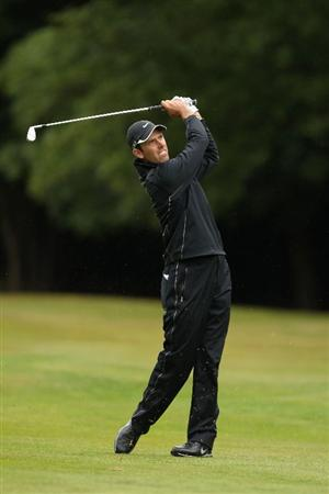 VIRGINIA WATER, ENGLAND - MAY 26:  Charl Schwartzel of South Africa plays an approach shot during the first round of the BMW PGA Championship at Wentworth Club on May 26, 2011 in Virginia Water, England.  (Photo by Ian Walton/Getty Images)