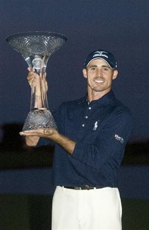 LAS VEGAS, NV - OCTOBER 24: Golfer Jonathan Byrd poses with the trophy after he hit a hole-in-one to win the tournament at the Justin Timberlake Shriners Hospitals for Children Open at TPC Sunderlin on October 24, 2010 in Las Vegas, Nevada. (Photo by Steve Dykes/Getty Images)