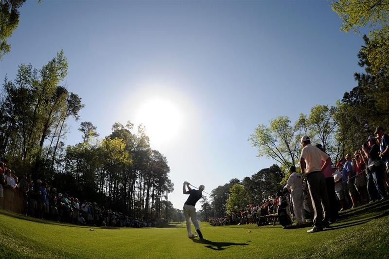 AUGUSTA, GA - APRIL 06:  Dustin Johnson hits a tee shot while a gallery of fans look on during a practice round prior to the 2010 Masters Tournament at Augusta National Golf Club on April 6, 2010 in Augusta, Georgia.  (Photo by Harry How/Getty Images)