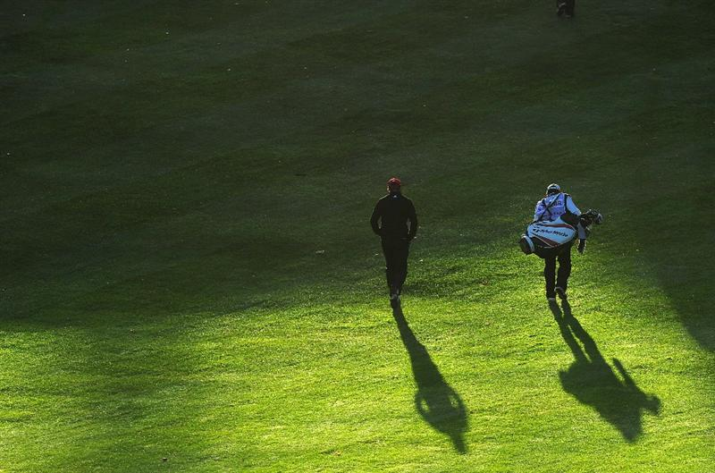 PARIS - SEPTEMBER 26: Sion Bebb of Wales and his caddie walk up the first hole during the final round of the Vivendi cup at Golf de Joyenval on September 26, 2010 in Chambourcy, near Paris, France.  (Photo by Stuart Franklin/Getty Images)