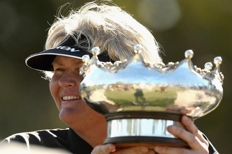 MELBOURNE, AUSTRALIA - FEBRUARY 15:  Laura Davies of England poses with the trophy after winning the 2009 Women's Australian Open held at the Metropolitan Golf Club on February 15, 2009 in Melbourne, Australia.  (Photo by Quinn Rooney/Getty Images)