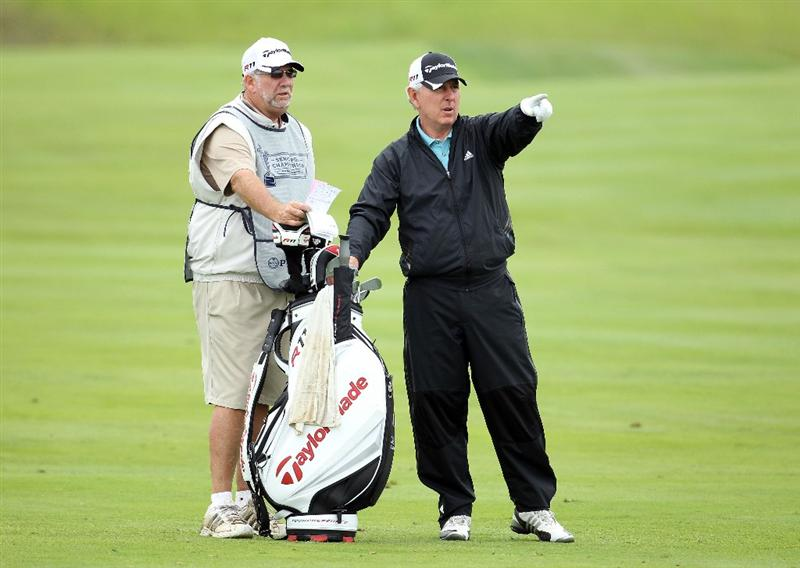 LOUISVILLE, KY - MAY 27:  Hale Irwin and his caddie discuss a shot on the par 5 7th hole during the second round of the Senior PGA Championship presented by KitchenAid at Valhalla Golf Club on May 27, 2011 in Louisville, Kentucky.  (Photo by Andy Lyons/Getty Images)
