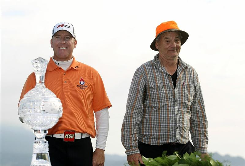 PEBBLE BEACH, CA - FEBRUARY 13:  Actor Bill Murray and D.A. Points wait at the trophy ceremony following the final round of the AT&T Pebble Beach National Pro-Am at the Pebble Beach Golf Links on February 13, 2011 in Pebble Beach, California.  (Photo by Ezra Shaw/Getty Images)