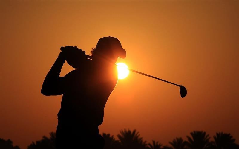 ABU DHABI, UNITED ARAB EMIRATES - JANUARY 22:  Camilo Villegas of Colombia warms up on the driving range against the rising desert sun before he started his second round of The Abu Dhabi Golf Championship at Abu Dhabi Golf Club on January 22, 2010 in Abu Dhabi, United Arab Emirates.  (Photo by David Cannon/Getty Images)