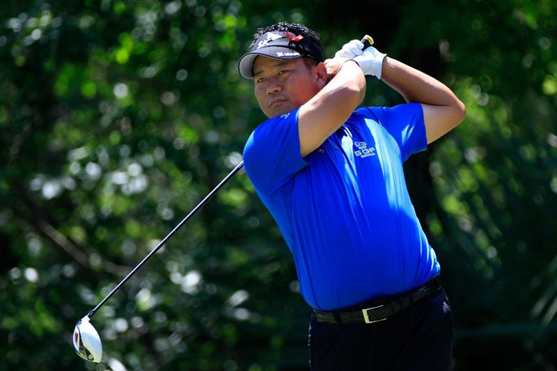 PONTE VEDRA BEACH, FL - MAY 15:  K.J. Choi of South Korea hits his tee shot on the fifth hole during the final round of THE PLAYERS Championship held at THE PLAYERS Stadium course at TPC Sawgrass on May 15, 2011 in Ponte Vedra Beach, Florida.  (Photo by Sam Greenwood/Getty Images)